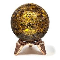 Orgonitboll med tigeröga och livets trädsymbol.