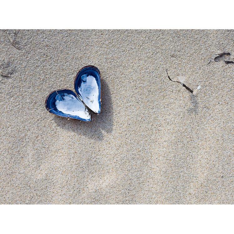 Hjärta på sandstrand
