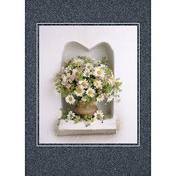 Vilda blommor på spishylla