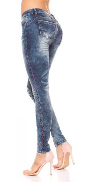 Jeans med rosa sømmer