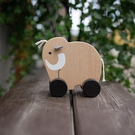 Mammut i trä på hjul