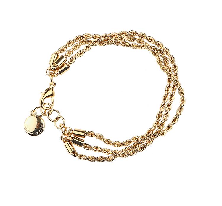 Presenttips Hege 3-string brace armband i guld från Snö of Sweden.