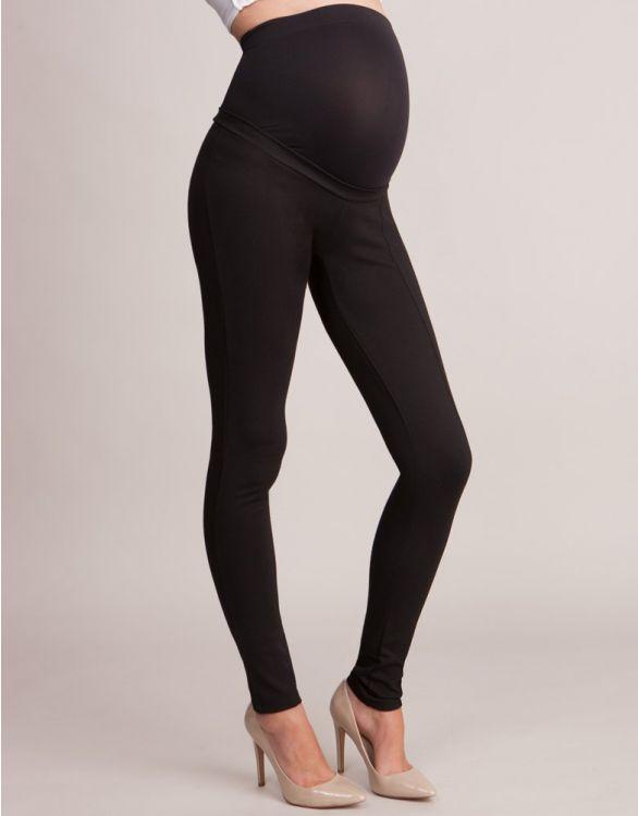 Svarta treggings för gravida zoomad på byxorna från sidan