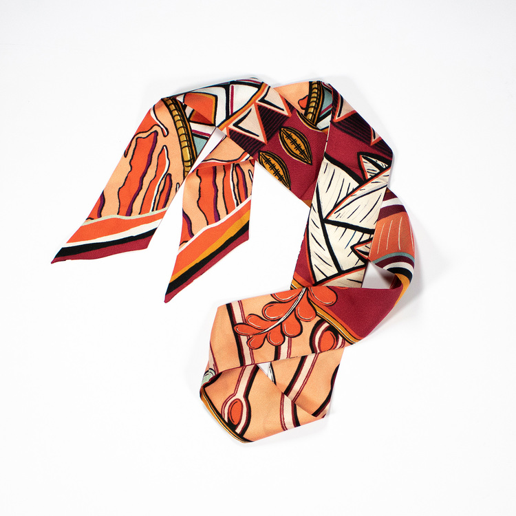 Twilly scarfette med fin mönster i orange