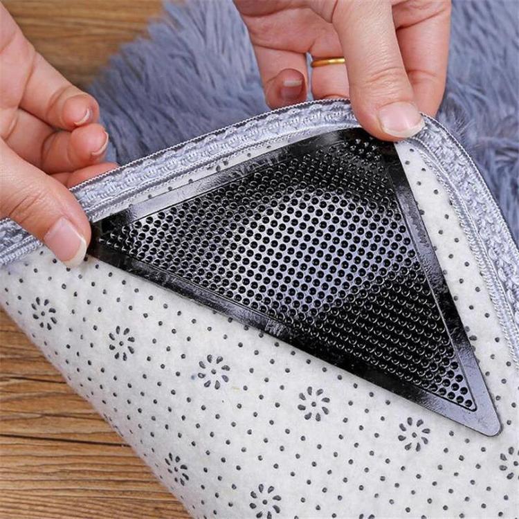 Halkskydd som monteras på mattans hörn