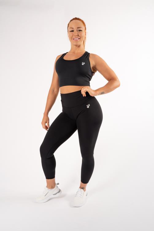 tjej med träningskläder i svart