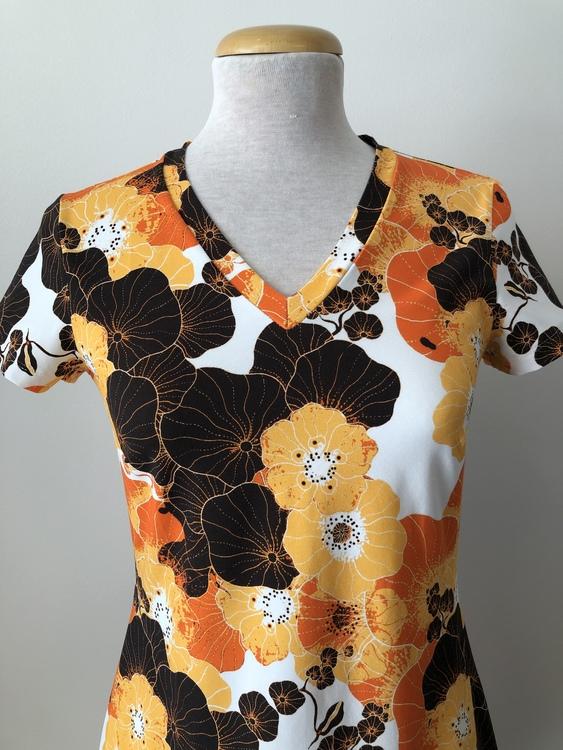 Engla klänning -Krasse orange
