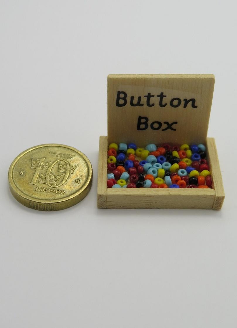 **Miniatyr** Knapp låda
