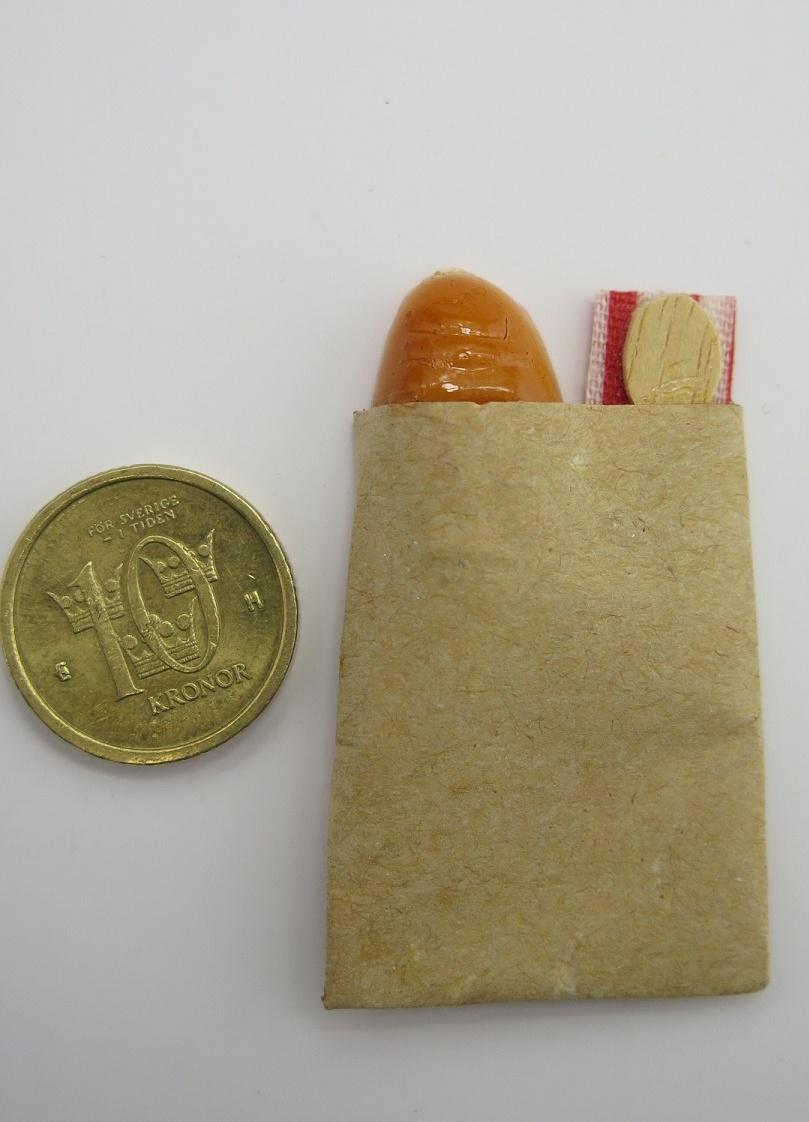 **Miniatyr** Påse med bröd