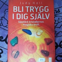 Bli trygg i dig själv : upptäck kristallernas magiska kraft av Judy Hall