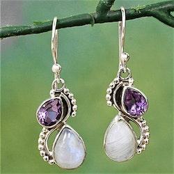 Örhängen med droppar av vit cateye sten och lila kristall