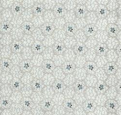 Nippon-kremfarget med blått mønster