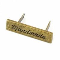 Skrift *Handmade* merke