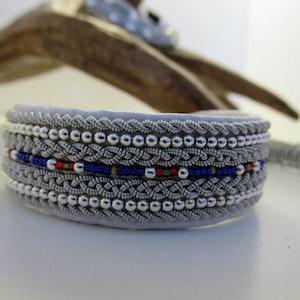 Tennarmband  bredare modell med silver och glaspärlor  1010D