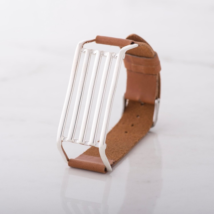 silverarmband med brunt läder. silver bracelet with brown leather