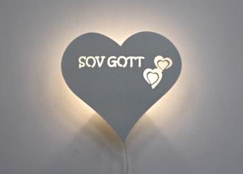 Hjärtformad vägglampa med texten SOV GOTT