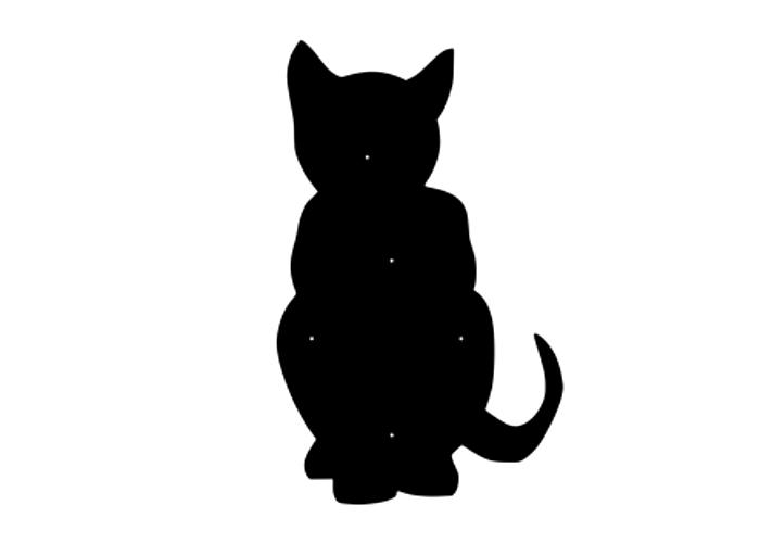 Fasaddekoration i form av siluetten av en sittande katt.