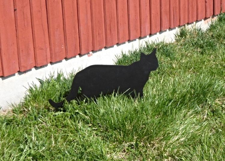 Trädgårdsdekoration i form av en katt.