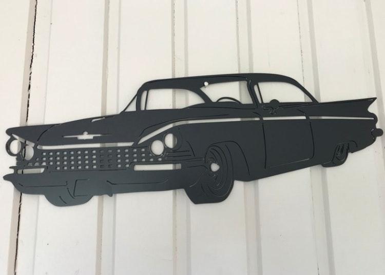 Svart Buick -59 i plåt.