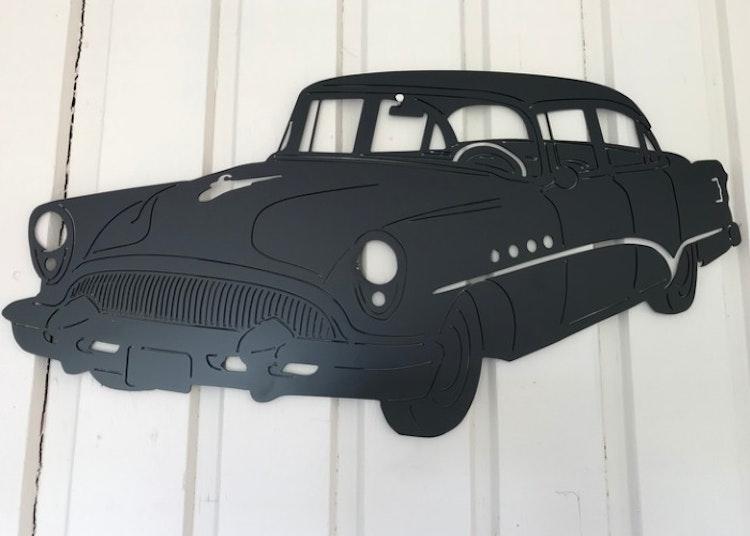 Buick Roadmaster -54 i plåt, svartlackerad.