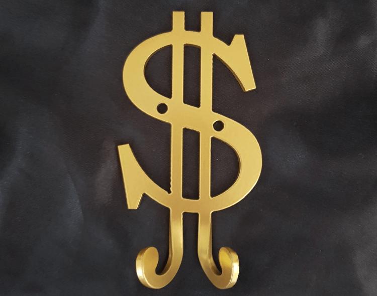 Guldlackerat dollartecken med 2st hängkrokar.