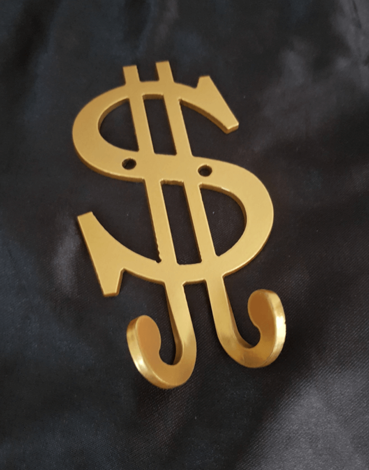 Dollartecken med krokar att sätta på väggen.