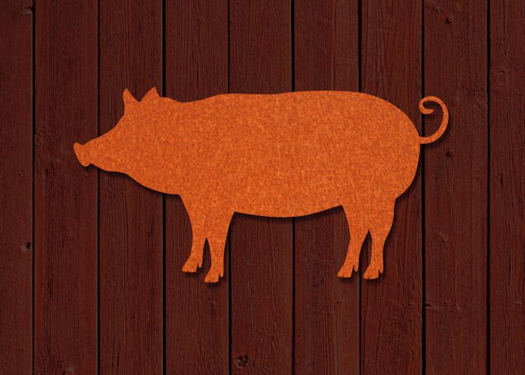 Fasaddekor av en gris skuren i cortenplåt.