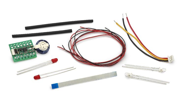 Slot.it - Universal lighting kit for analog and digital