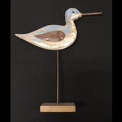 Träfågel med brun vinge