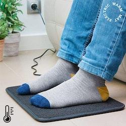 Elektrisk värmematta värmer fötterna