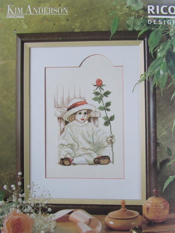 Korsstygnstavla Flicka designad av Kim Anderson. Sys med räknade korsstygn. Storlek 30 x 40 cm.