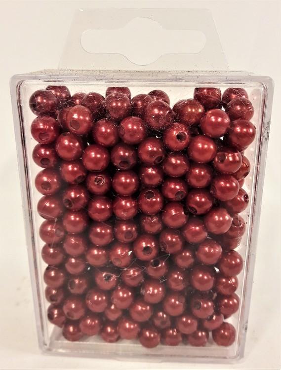 Röda kulor med hål, för dekoration