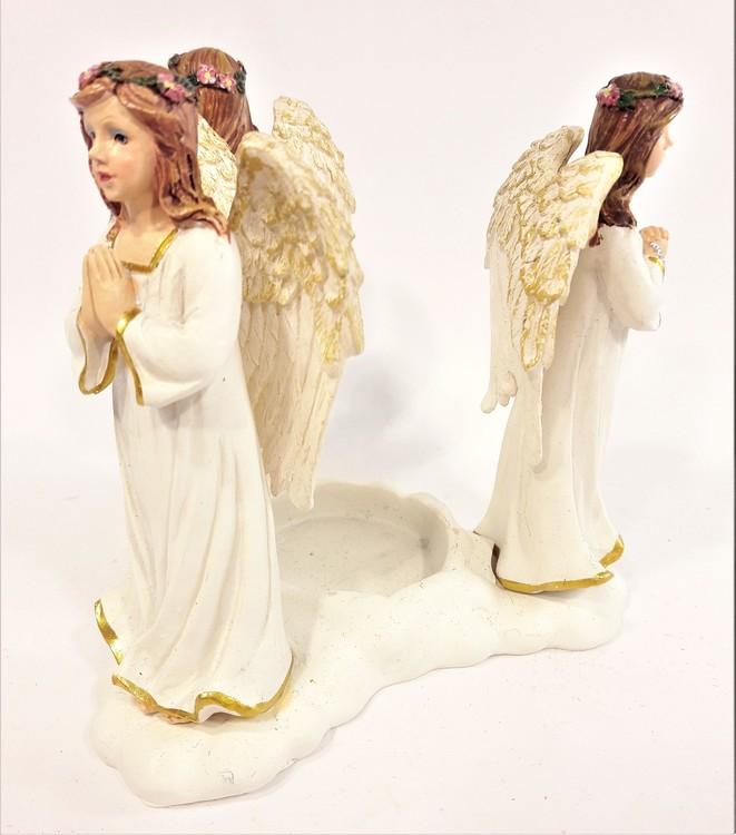 Värmeljushållare med änglar i polystone, marmorkross blandat med polyesterakrylat. Detaljfull och dekorativ.