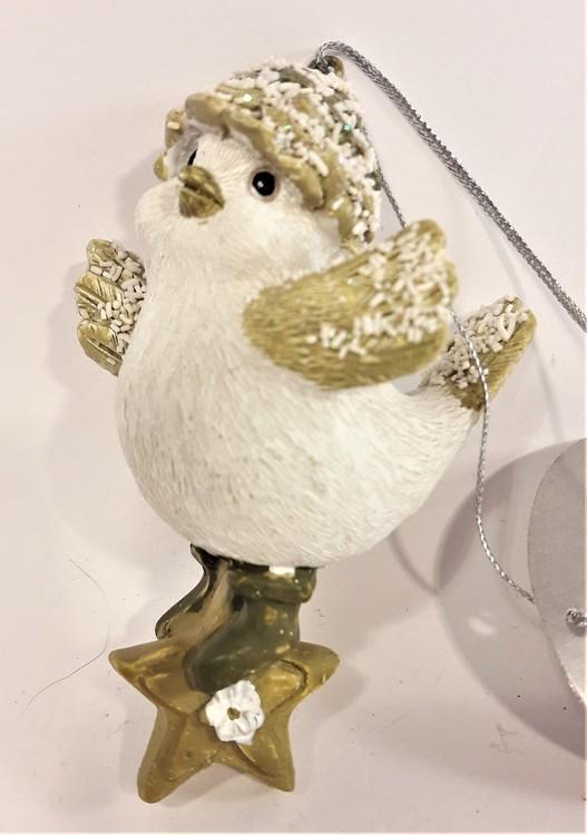 Söt fågel på stjärna att hänga, i polystone, marmorkross blandat med polyesterakrylat. Detaljfull och dekorativ.