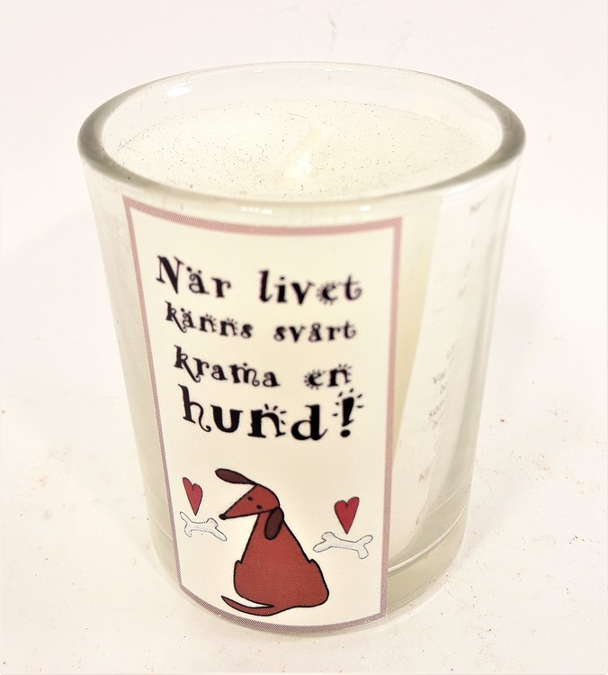 Litet handstöpt doftljus i glas med text