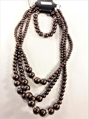 Set med treradigt halsband och armband i bronsfärgade pärlor med strass