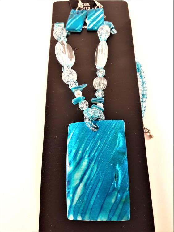 Halsband och örhänge med snäckskal, blå