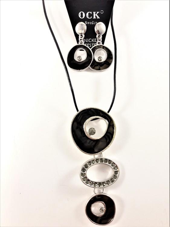 Halsband med strass och svarta detaljer samt matchande örhängen