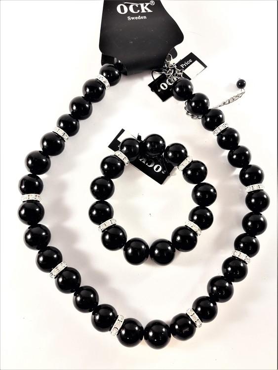 Halsband med svarta kulor och strass med matchande armband