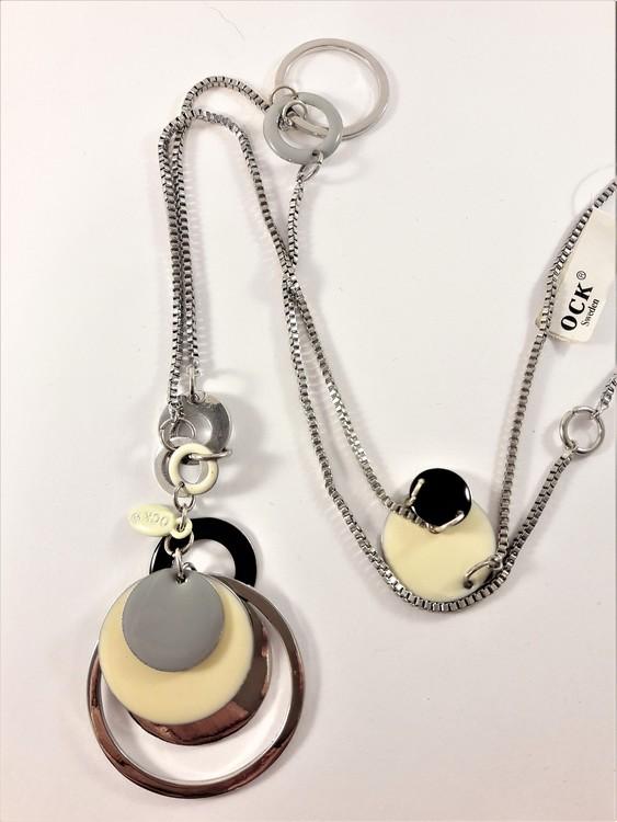 Halsband med detaljer silverfärg och vit