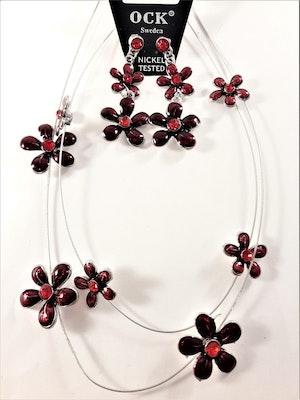 Halsband med röda blommor samt matchande örhängen