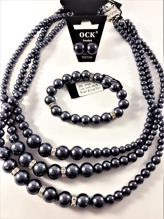 3-radigt halsband med lila kulor och strass med matchande armband och örhängen