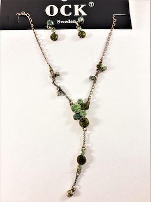 Set med halsband och örhänge i gnistrande grönt