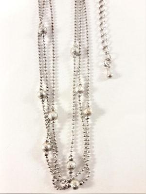 Fotlänk med pärlor