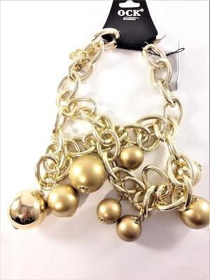 Halsband med stora kulor i guldfärg,