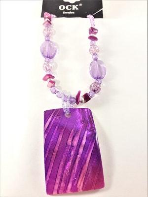 Halsband med lila detaljer och snäckskal