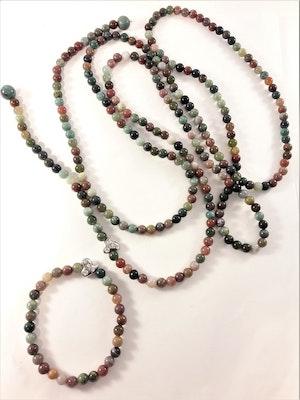 Öppet halsband med olikfärgade kulor och litet hjärta med strass, med matchande armband