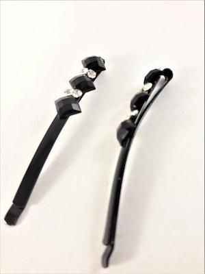 Hårklämma med svarta och glittriga detaljer