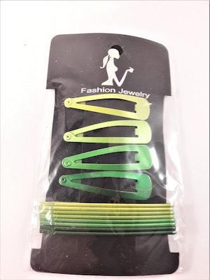 Set med 8 hårspännen och klämmor i grön ton