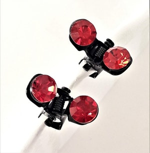 Små hårklämmor med glittrande röd sten, 2 st